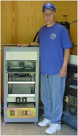 Mark, N8UVQ standing next to the SHARC-3 Repeater